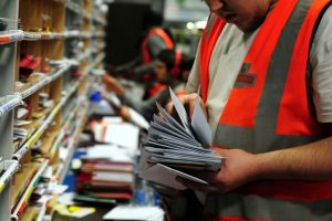 royal mail worker sorting mail
